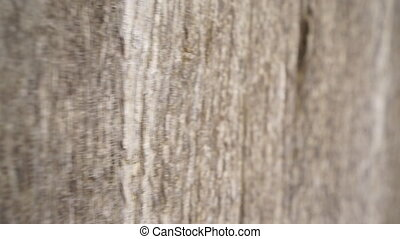 Sliding camera over wooden door and rusty lock - Closeup of...