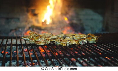 Sliding camera up to lamb chops on grill - Lamb chops on...