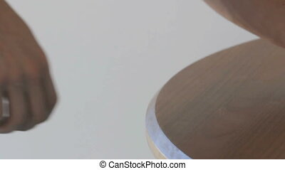 Sliding coins off a table