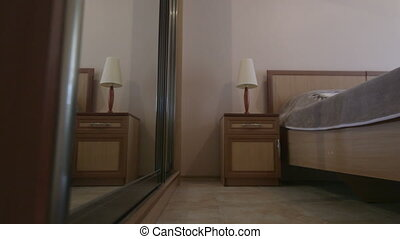 Sliding door mirror wardrobe in modern hotel bedroom interior