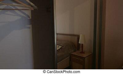 Sliding door mirror wardrobe in modern hotel bedroom interior