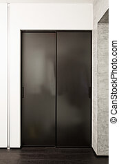 Sliding-door wardrobe in modern hall interior