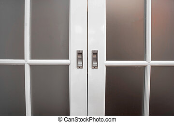 sliding glass and wood door close-up, vintage design home concept background