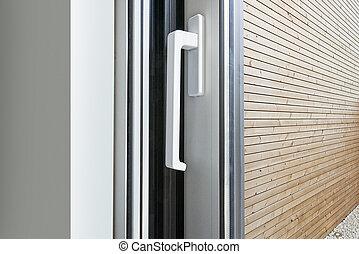 Sliding glass door handle opening on garden