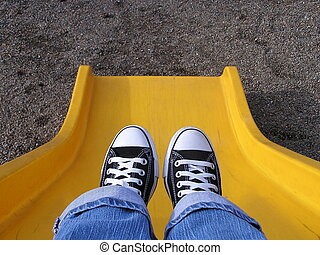 Sliding in Style - person going down a slide
