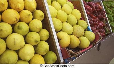 Sliding over lemons, apples and pepper boxes - Closeup...