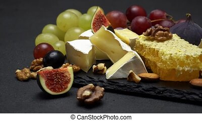Video of brie cheese, honey and grapes - Sliding Video of...