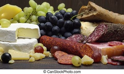 Video of various types of cheese and sausage - parmesan,...