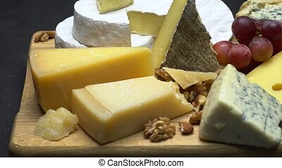 Video of various types of cheese - parmesan, brie, roquefort...