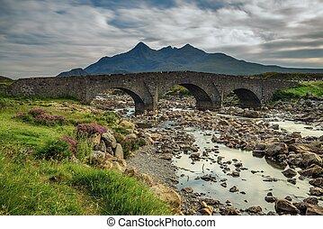 Sligachan bridge with Cuillins Hills on isle of Skye, Scotland, United Kingdom. Long exposure.