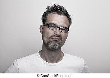 slightly annoyed man - man with stubble beard is slightly...