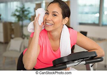 slim beautiful sporty happy woman working in the gym
