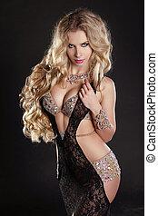 Slim beautiful woman with long hair wearing luxurious dress...