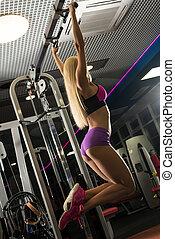 Slim blonde in sexy sportswear on a crossbar