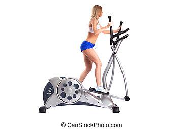 Slim blonde woman on exerciser