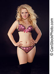 8a9a9a36983ff Slim body of young woman in lingerie. Girl with healthy sporty figure  isolated on black