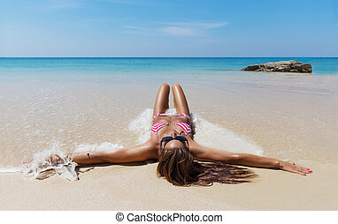 slim brunette woman in sunglasses sunbathe beach