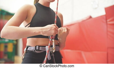 slim fit girl with a belt and rope on her body is ready for...