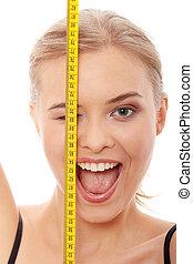 Slim girl - Beautiful young caucasian woman measuring her...