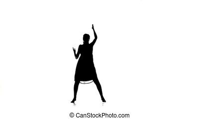 Slim girl dancer dancing contemporary dance on white, silhouette, slow motion