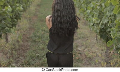 Slim girl dancing in the vineyard