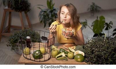 Slim Girl Enjoys Salad - Pretty, slim girl enjoys a...