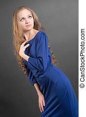 slim girl in a blue dress