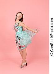 slim girl in a dress