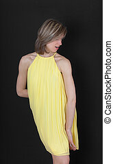 slim girl in a yellow dress