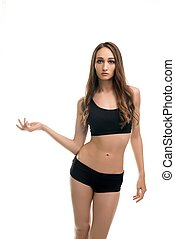 Slim girl in black top and shorts isolated view