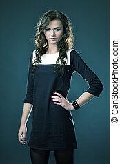 Slim girl in studio portrait