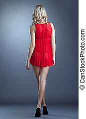 Slim girl posing in red negligee, back to camera - Slender ...