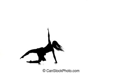 Graceful slim young woman in light dress with long hair dance contemporary style ballet dancer and jumps, white, silhouette, slow motion
