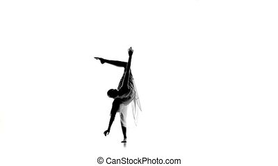 Slim girl with ponytail dance modern contemporary style on white, silhouette, slow motion