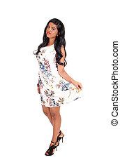 Slim Indian woman standing.