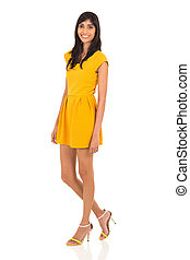 slim indian woman standing on white background