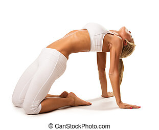 slim young woman doing back stretching exercise young