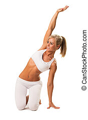 Slim sexy woman doing stretching exercise
