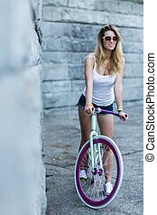 Slim sexy woman on bike