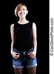 Slim Smiling Asian American Woman Standing Black Background
