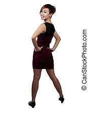 Slim Smiling Asian American Woman Standing In Red Dress