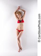 Slim underwear model posing barefoot
