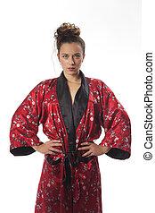 slim woman in a kimono on white