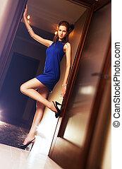 Slim woman in blue dress