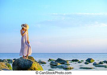 Slim woman in summer dress at seaside