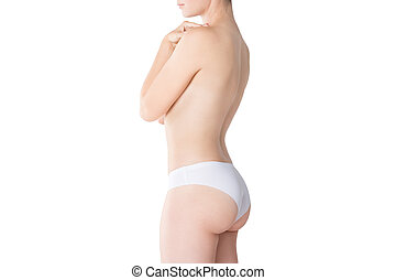Slim woman topless in white panties isolated on white background, perfect female body