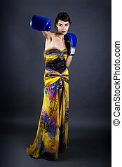 Slim Woman Wearing a Dress and Boxing Gloves