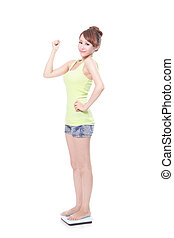 slim woman with scales - Beautiful slim woman with scales in...