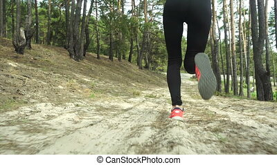 slim young girl in sports uniform running outdoors in the...