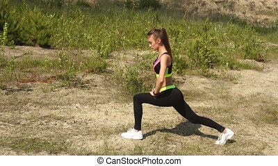 Slim young lady in sports uniform practicing outdoors